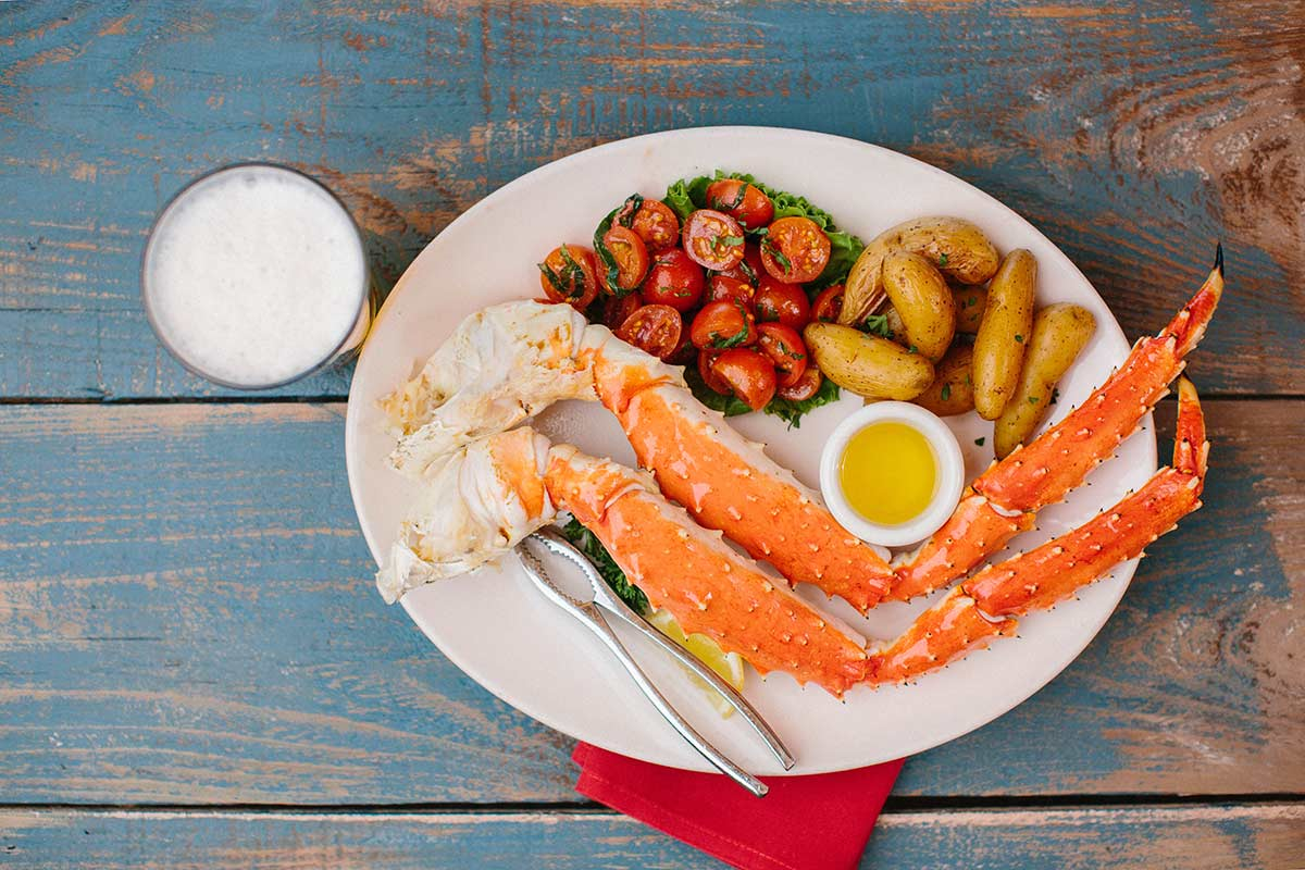 King crab legs with potatoes and tomatoes