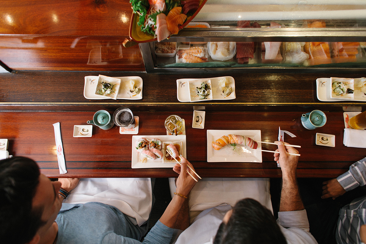 couple eating sushi at the sushi bar